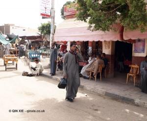 Man on phone, Edfu, Egypt