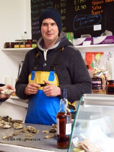Man in oyster shed, Isle of Skye, Scotland