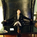 Qin Xie in giant chair, Geneva