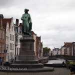 Statue by river, Bruges, Belgium