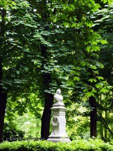 Statue in trees, Bruges, Belgium